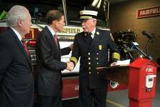 Fire Chief Denis McCarthy shakes hand with U.S. Senator Richard Blumenthal during a press conference in front of the Fairfield Fire Department headquarters in Fairfield, Conn. Oct. 18, 2019. Blumenthal joined McCarthy and First Selectman Mike Tetreau to announce a FEMA grant the Fairfield Fire Department recently received.