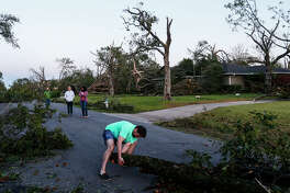 Homeowner Eric Chartan works to clear debris so he can drive his kids to school after a tornado the night before near Northcrest Road and Crestline Avenue in Dallas, Texas on Monday, Oct. 21, 2019.