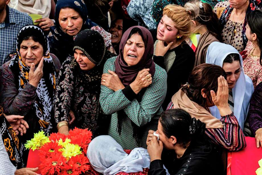 Mourners attend the funeral of those killed in attacks by Turkish-led forces in the Syrian Kurdish town of Ras al-Ain. Donald Trump's betrayal of the Syrian Kurds  is a moral travesty devoid of strategic purpose. Photo: DELIL SOULEIMAN /AFP Via Getty Images / AFP or licensors
