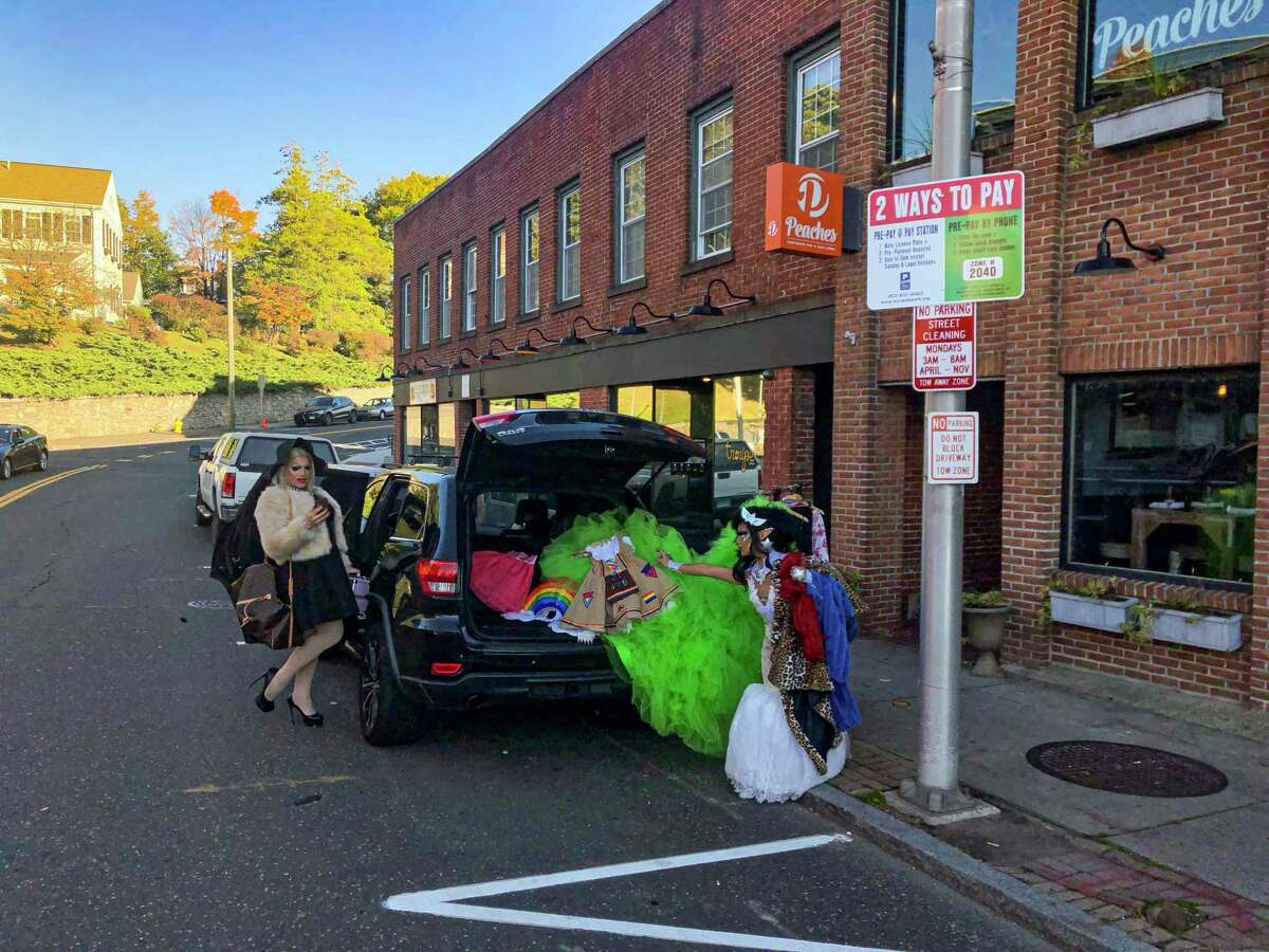 Anita Manager and Robin Richards unload a car full of costumes and wigs before performing at Troupe 429, on Wall Street, Norwalk, Oct. 19, 2019.