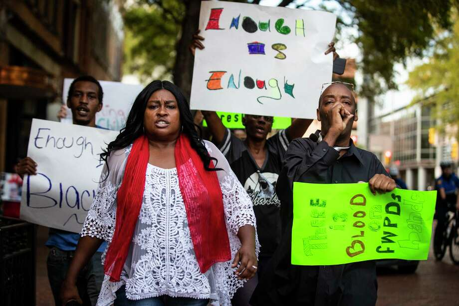 Protesters against the killing of Atatiana Jefferson by a white Fort Worth police officer, march down Main Street in downtown Fort Worth, Oct. 15. A reader says it may be time to disarm the police. Photo: Yffy Yossifor /Associated Press / Star-Telegram
