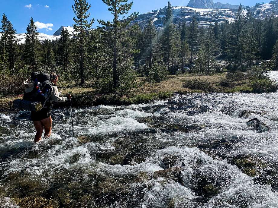 Thru-hiker Elise Ott fording a river on the Pacific Crest Trail in the Sierra in 2019. Photo: Courtesy Elise Ott