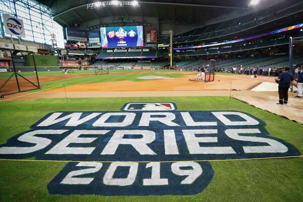 The World Series logo is painted on the field before Game 1 of the World Series between the Houston Astros and the Washington Nationals at Minute Maid Park on Monday, Oct. 21, 2019, in Houston.