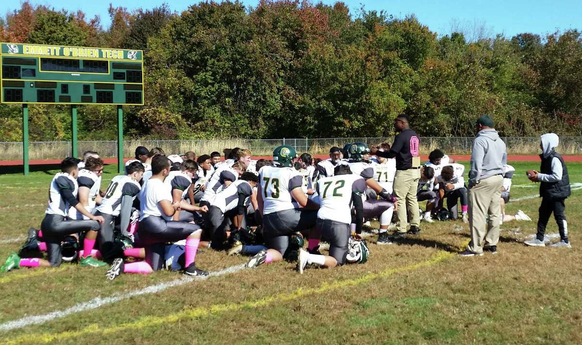 New defensive coordinator Robert Hayes talks to the O'Brien Tech football team in the huddle after the Condors' 44-0 win over MCW United on Saturday, Oct. 19, 2019 in Ansonia.