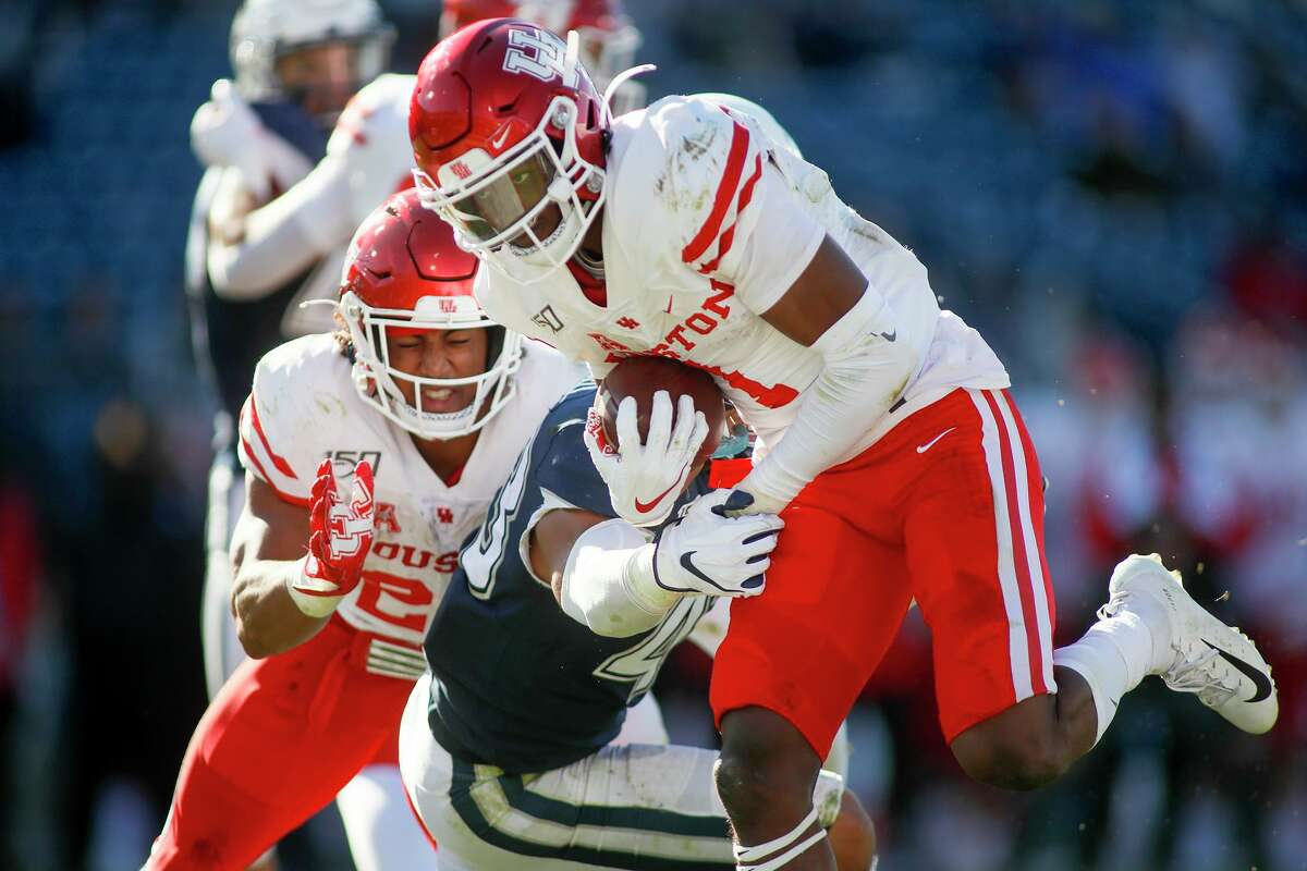 Bryson Smith came to UH as a quarterback but quickly moved to receiver. Now, because of injuries, he's working out of the Wildcat formation in the backfield to help.
