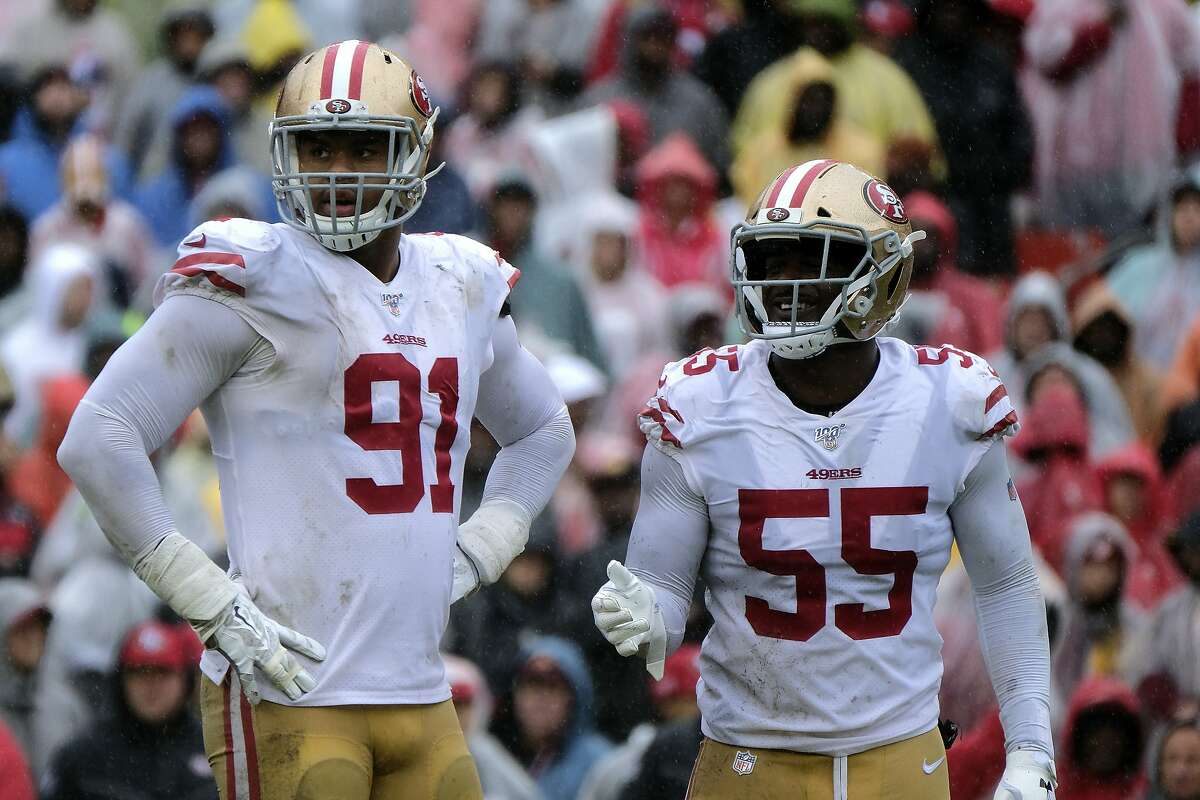 San Francisco 49ers defensive end Arik Armstead (91) and defensive end Dee Ford (55) stand on the field during an NFL football game against the Washington Redskins, Sunday, Oct. 20, 2019, in Landover, Md. (AP Photo/Mark Tenally)