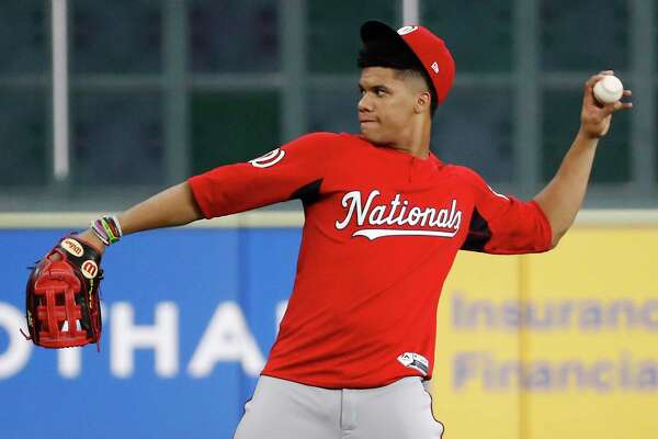 Washington Nationals left fielder Juan Soto works out in preparation for Game 1 of the World Series against the Houston Astros at Minute Maid Park on Monday, Oct. 21, 2019, in Houston.
