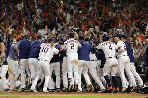 Members of the Houston Astros celebrate Jose Altuve's game-winning home run in the ninth inning of Game 6 of the American League Championship Series at Minute Maid Park in Houston, Oct. 19, 2019. The Astros won 6-4 to advance past the New York Yankees to the World Series. (Todd Spoth/The New York Times)