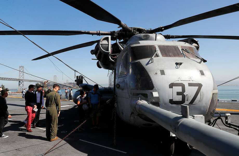 People visit a Marine CH-53 helicopter on the flight deck of the USS Essex docked at Piers 30-32 as fleet week kicks off in San Francisco in 2017. A ride in a helicopter provided insights on helicopter parenting. Photo: Michael Macor / The Chronicle 2017