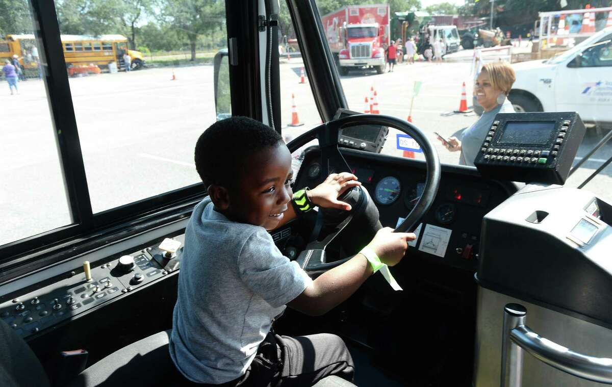 Jakob Turner takes the wheel of a city bus during the Beaumont Children's Museum's annual Touch-a-Truck fundraiser Saturday. Photo taken Saturday, October 19, 2019 Kim Brent/The Enterprise