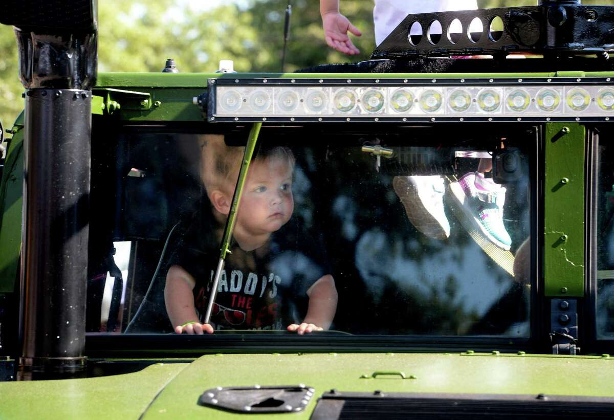 Garrison Drake peers out from the front windshield of a military vehicle while exploring with family during the Beaumont Children's Museum's annual Touch-a-Truck fundraiser Saturday. Photo taken Saturday, October 19, 2019 Kim Brent/The Enterprise