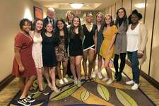 The Trinity Catholic Crusaders girls basketball players pose for a picture at the Fairfield County Sports Commission's annual Sports Night awards dinner at the Stamford Marriott on Monday. The Crusaders were honored as Stamford's Sports Persons of the Year for winning the CIAC Class S championship.