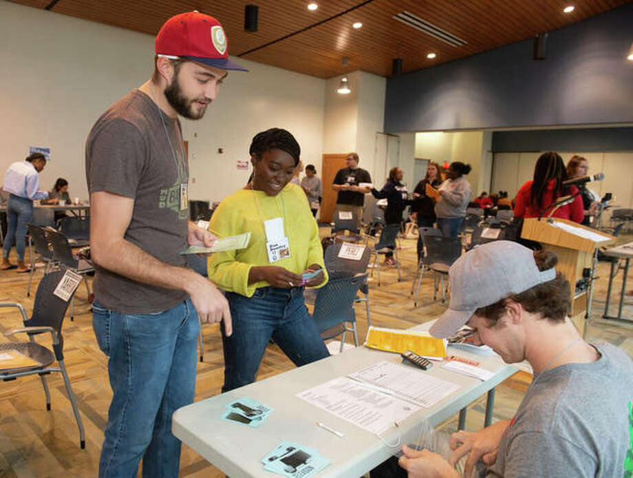 (L-R) SIUE students Jake Schnettler a senior majoring in civil engineering; and Kaylin Daggs, a junior majoring in public health, talk to one of the community resources about something they need. Photo: For The Intelligencer