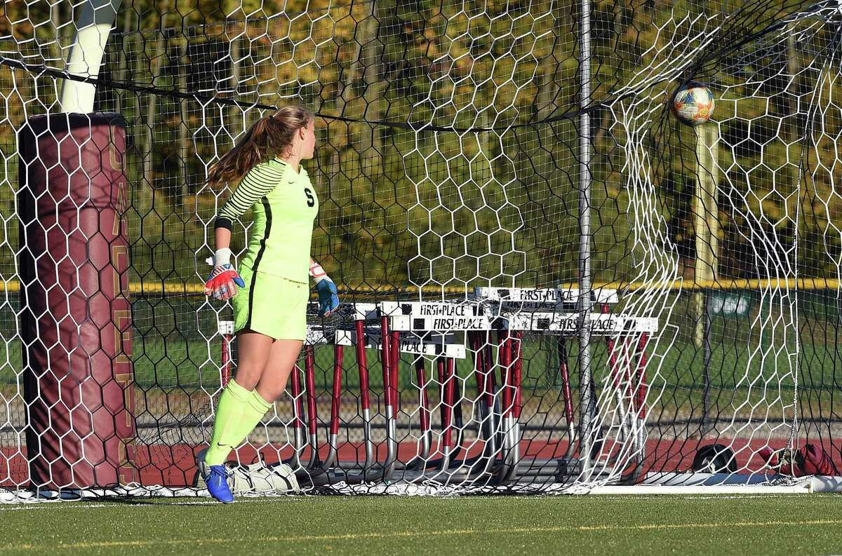 Staples goalie Marisa Shorrock watches a penalty kick by St. Joseph's Maddie Fried go into the net in the second half on Monday.