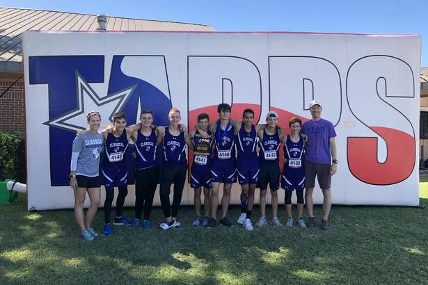 The Midland Classical Academy boys cross-country team and coaches pose after the Knights finished second at the TAPPS 3A state championship meet in Waco on Monday.