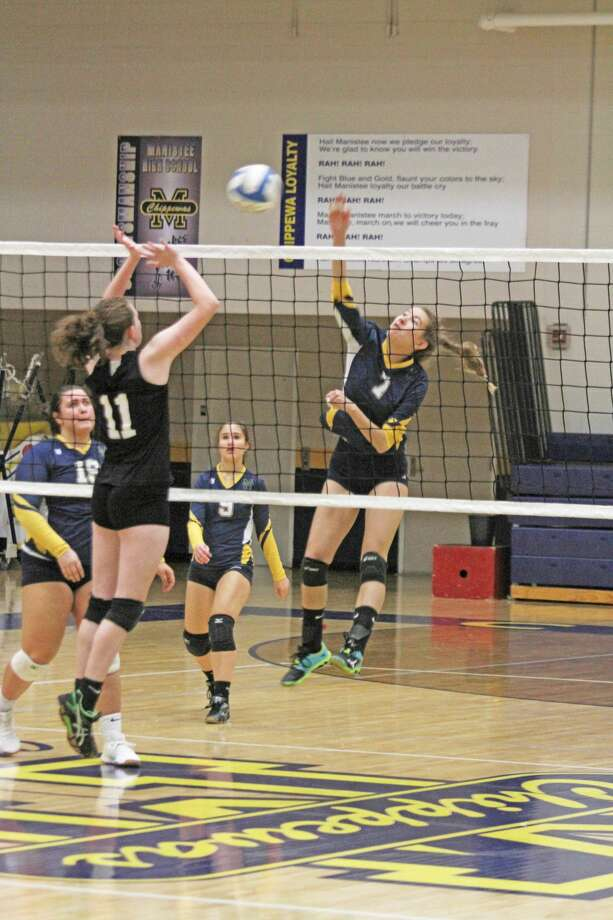 Manistee's Morgan Ju spikes the ball Monday night during the Chippewas' sweep of Mason County Eastern. Photo: Dylan Savela/News Advocate