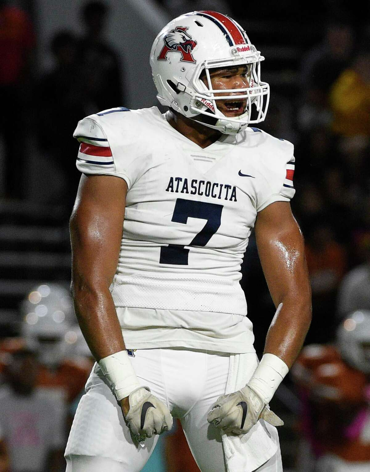 Atascocita defensive lineman Asyrus Simon celebrates his sack of Dobie quarterback Cameron Gray during the first half of a high school football game, Friday, Oct. 18, 2019, in Pasadena, TX.