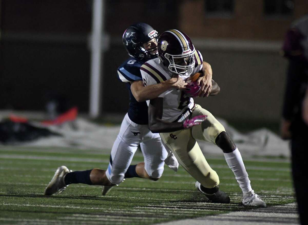 Kingwood sphomore defensive back Evan Richard, left, pushes Summer Creek junior wide receiver Elijah Bean out of bounds on a pass play in the 1st quarter of their District 22-6A matchup at Tuirner Stadium in Humble on Oct. 18, 2019.