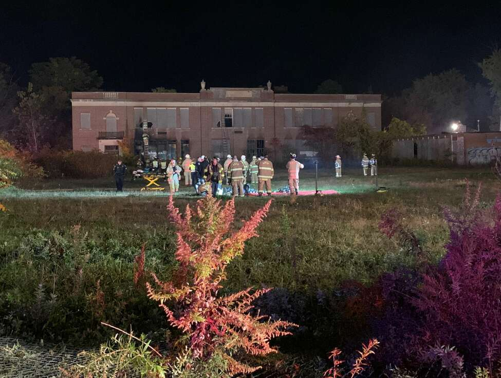 A portion of Central Avenue was closed Monday night while firefighters battled a blaze inside an abandoned former school building. Traffic was diverted onto side roads. (Amanda Fries / Times Union)