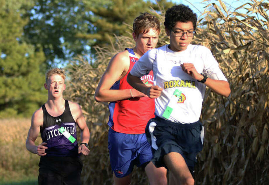 Roxana's Carlos Ruvalcaba (right), Carlinville's Briley Roper (middle) and Litchfield's Will Carlile lead the field late in the opening mile of the South Central Conference boys cross country meet Monday at Schneider Park in Brighton, Ruvalcaba won the race, with Roper finishing third and Carlile in fourth. Photo: Greg Shashack / The Telegraph