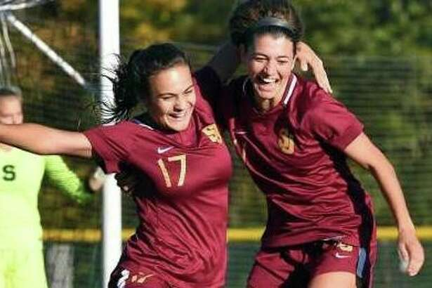 St. Joseph's Maddie Fried celebrates with teammate Anastasia Kydes after scoring on a penalty kick in the second half on Monday.