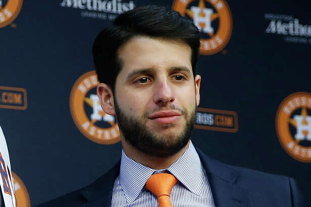 The Astros disputed a Sports Illustrated report that said assistant general manager Brandon Taubman yelled in the direction of three female reporters in the clubhouse following Saturday's ALCS clincher.
