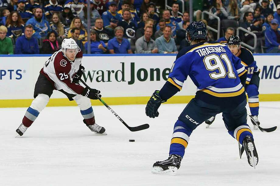 Colorado Avalanche's Nathan MacKinnon (29) handles the puck as St. Louis Blues' Vladimir Tarasenko (91), of Russia, and Jaden Schwartz (17) defend during the second period of an NHL hockey game Monday, Oct. 21, 2019, in St. Louis. (AP Photo/Scott Kane) Photo: Scott Kane / Copyright 2019 The Associated Press. All rights reserved.