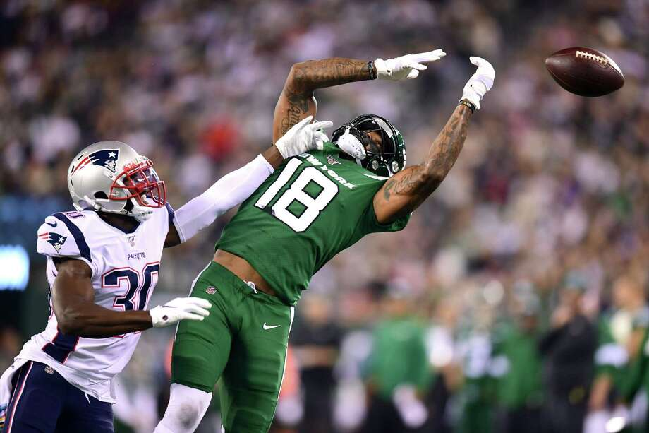 EAST RUTHERFORD, NEW JERSEY - OCTOBER 21: Jason McCourty #30 of the New England Patriots guards Demaryius Thomas #18 of the New York Jets as he fails to complete a pass in the second quarter of their game at MetLife Stadium on October 21, 2019 in East Rutherford, New Jersey. (Photo by Emilee Chinn/Getty Images) Photo: Emilee Chinn / 2019 Getty Images