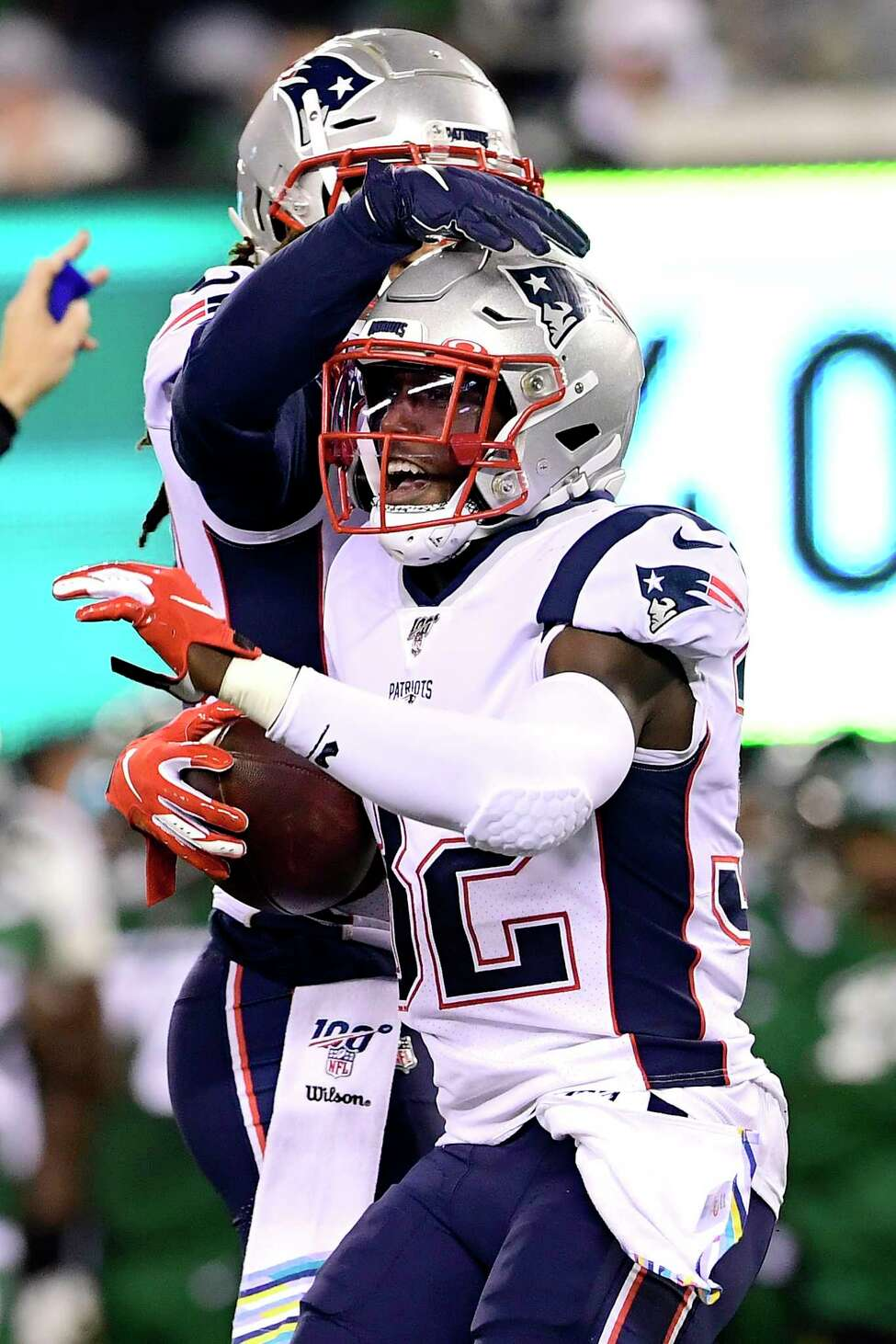 EAST RUTHERFORD, NEW JERSEY - OCTOBER 21: Devin McCourty #32 of the New England Patriots is congratulated by his teammate Stephon Gilmore #24 after intercepting the ball against the New York Jets of the New England Patriots during the first half at MetLife Stadium on October 21, 2019 in East Rutherford, New Jersey. (Photo by Steven Ryan/Getty Images)
