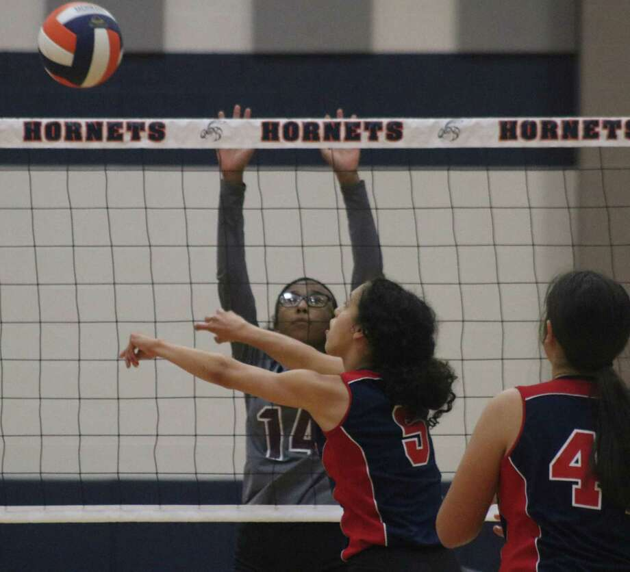 Bondy Intermediate's Julixa Cintron avoids the Lady Indian on the other side of the net by looking for an opening more in the middle of the court. It was one of four opening-round contests of the 8A postseason tournament. Photo: Robert Avery