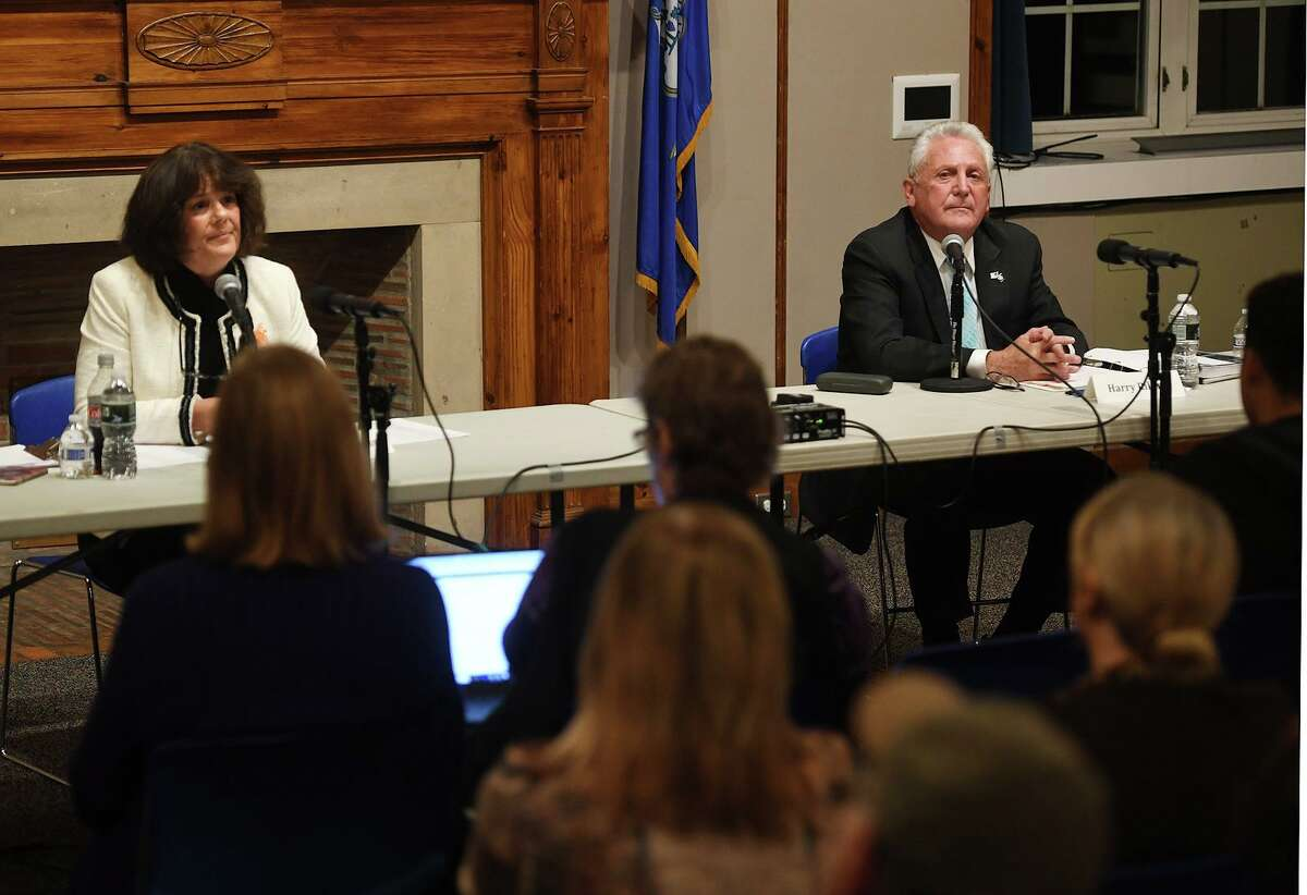 Norwalk Mayor Harry Rilling and challenger Lisa Brinton debate for the first time to a standing room only packed community room at Norwalk City Hall in Norwalk, Conn. on Monday, October 21, 2019.