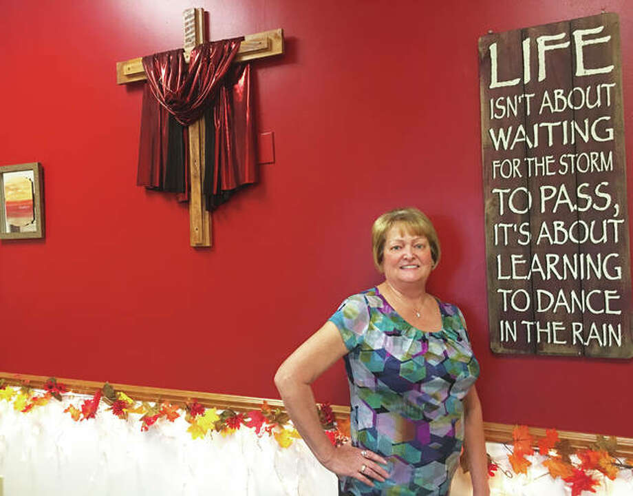 Denise Shampine, 62, of East Alton, stands in the meeting room of Sister Support, a cancer support group for women, at Roberta's Lovely Ladies Boutique, 603 W. Delmar, in Alton. The independently owned retail store specializes in mastectomy bras and swimwear, wigs and mature bras. The specialty destination is owned by Carol Logan, of Godfrey, the founder of Sister Support, which she co-leads with Shampine, a nine-year breast cancer survivor, from 2 to 4 p.m. the first Saturday of each month at Roberta's. All women are welcome, meetings are free to attend and refreshments are served. Photo: (Jill Moon|Hearst Illinois Media Group)
