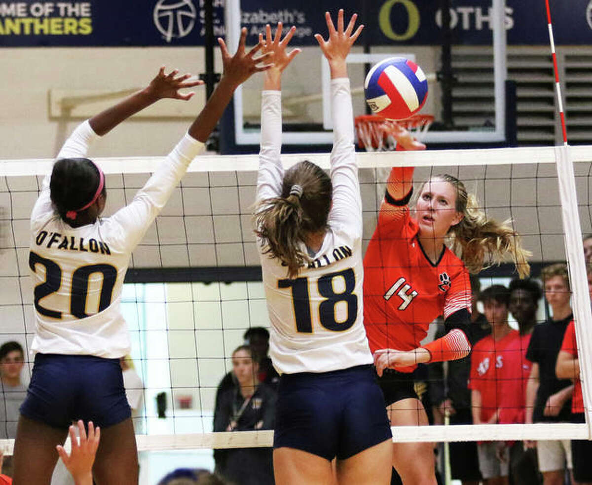 Edwardsville's Maddie Isringhausen (right), shown getting a kill past a double block from O'Fallon in a Sept. 3 match at O'Fallon, had 11 kills in the Tigers' win Monday night at Breese Mater Dei.