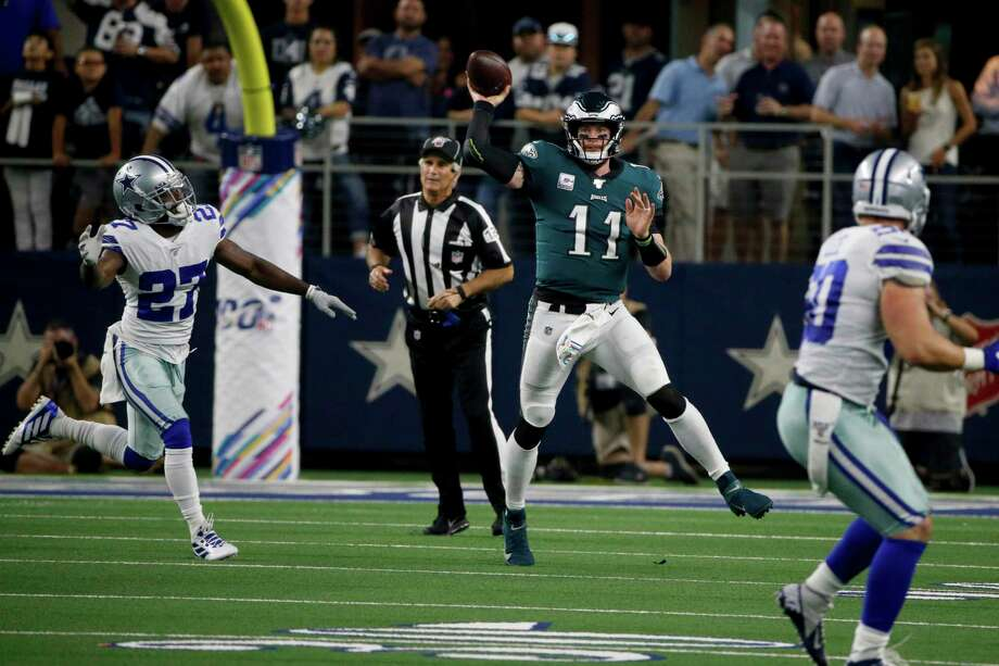 Dallas Cowboys cornerback Jourdan Lewis (27) gives chase as Philadelphia Eagles quarterback Carson Wentz (11) throws a pass during an NFL football game in Arlington, Texas, Sunday, Oct. 20, 2019. Shown on NBC, the game drew about 22 million viewers. Photo: Michael Ainsworth / Associated Press / Copyright 2019 The Associated Press. All rights reserved.