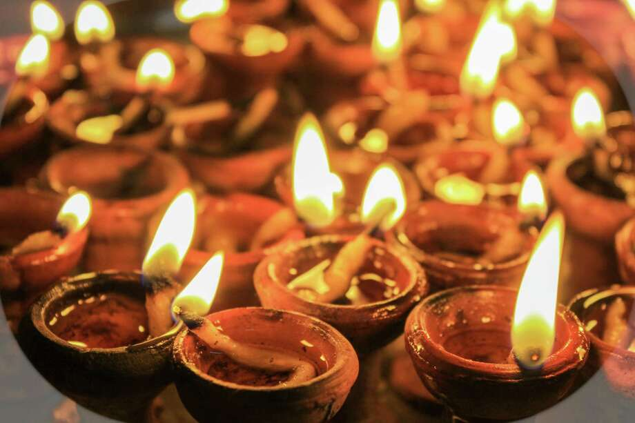 Diwali/Dipawali is an auspicious festival for Hindus all over the world and for India. People celebrate the festival by lighting lamps made of wick and oil during festive season. Photo: Dreamstime / © Parthkumar Bhatt/Dreamstime