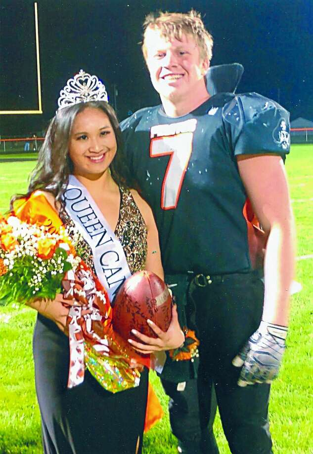 Kathryn Ocomen was crowned Harbor Beach Homecoming Queen during the Pirates' homecoming football game. She was escorted by Devin Pfaff. Photo: Submitted Photo