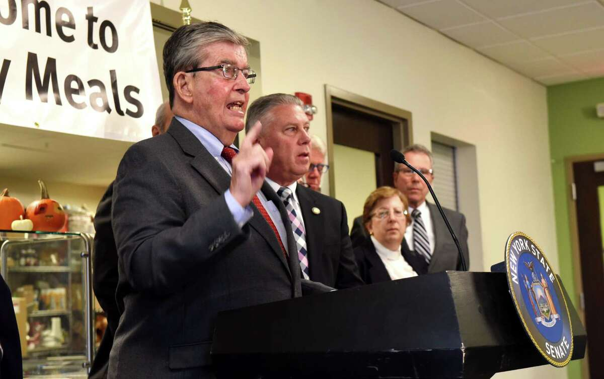 Sen. Neil Breslin, left, and Assemblyman John T. McDonald III, second from left, speak during a press conference to announce legislation to improve access to New York?•s early voting system on Tuesday, Oct. 22, 2019, at Unity House in Troy, N.Y. The proposed law would require that at least one early voting polling station be located within a county's largest municipality, and be accessible via public transportation, where available. (Will Waldron/Times Union)