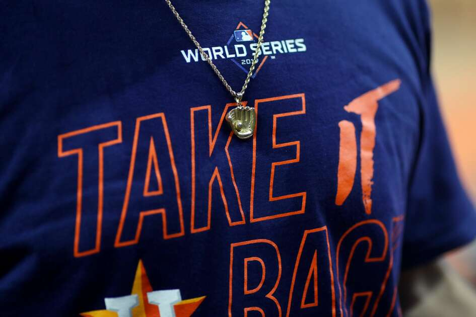 HOUSTON, TX - OCTOBER 21: A detail shot of a chain with a baseball glove and ball charm worn by an Houston Astros player during the World Series Workout Day at Minute Maid Park on Monday, October 21, 2019 in Houston, Texas. (Photo by Alex Trautwig/MLB Photos via Getty Images)