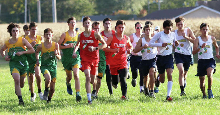 Boys from Southwestern, Staunton and Roxana run from the starting line in the South Central Conference cross country meet on Monday at Schneider Park in Brighton. Photo: Greg Shashack / The Telegraph