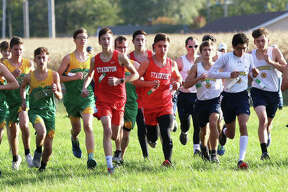 Boys from Southwestern, Staunton and Roxana run from the starting line in the South Central Conference cross country meet on Monday at Schneider Park in Brighton.