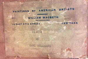 """Description placed on the back of a painting, """"Winter,"""" by artist Gari Melchers. It was purchased from the Macbeth Art Gallery in New York City in 1934 by Bartlett Arkell, president of the Beechnut Packing Co. in Canajoharie and founder of the art museum there. The FBI recently seized a painting from an art museum in Canajoharie, part of an international effort to recover artwork stolen by the Nazis from the heirs of jewish publisher Rudolf Mosse, a philanthropist who died in 1920. (U.S. Government exhibit)"""