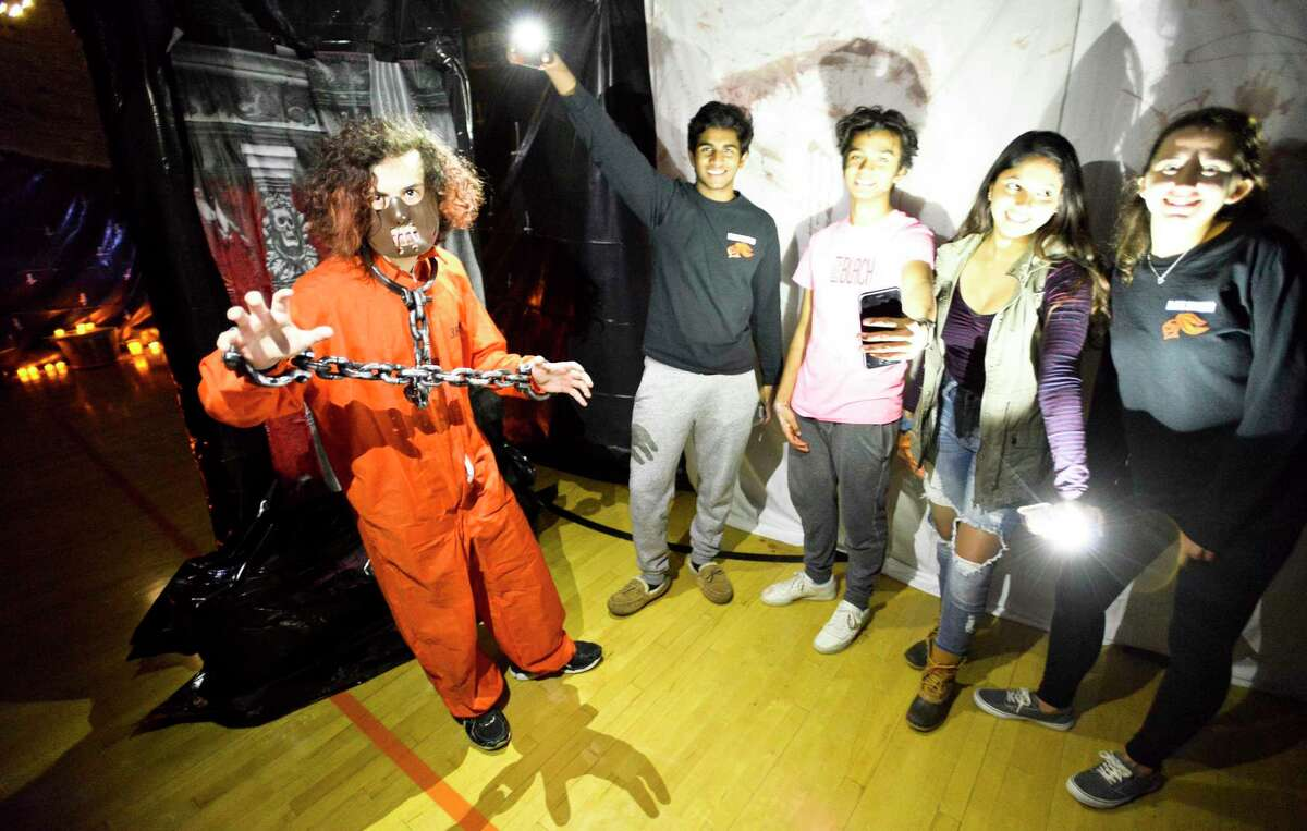 From left Christian Tarzia and members of the Senior Class Student Council, Adarsh Sushanth, Lalith Goli, Geetha Weerakoon and Samantha Heller set up for the sixth annual Haunted Scare House at Stamford High School in Stamford, Connecticut., Friday, Oct. 19, 2018. The haunted house is back again this year, one of many Halloween-themed events to check out in Stamford this month.