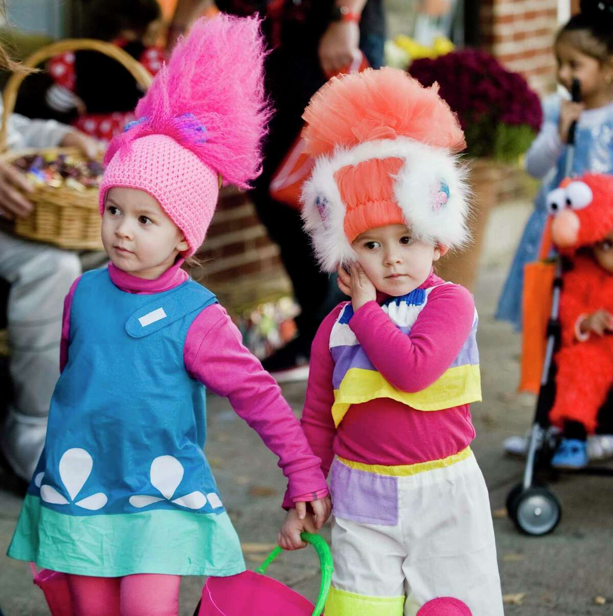 Twins Piper and Penelope Howatt, 3, search for candy on Main Street.