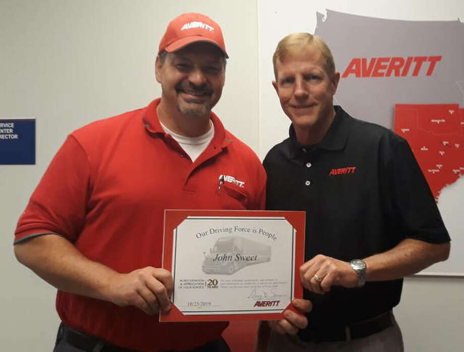 """John Sweet, left, is welcomed to the Averitt """"Over 20 Team"""" by St. Louis service center director Scot Hollocher. Photo: Submitted"""