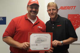 "John Sweet, left, is welcomed to the Averitt ""Over 20 Team"" by St. Louis service center director Scot Hollocher."