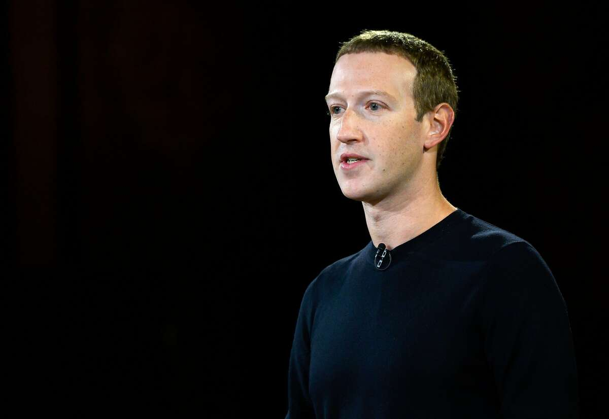 """(FILES) In this file photo taken on October 17, 2019 Facebook founder Mark Zuckerberg speaks at Georgetown University in a 'Conversation on Free Expression"""" in Washington, DC. - Facebook said on October 21, 2019 it was tightening its security for the 2020 US elections, with stepped up scrutiny of """"state controlled"""" media seeking to manipulate American voters.The moves add to a series of measures from the leading social network since 2016, when foreign entities were prominently involved in social media in the US campaign.""""The bottom line here is that elections have changed significantly since 2016, and Facebook has changed too,"""" Facebook chief executive Mark Zuckerberg told a conference call. (Photo by ANDREW CABALLERO-REYNOLDS / AFP) (Photo by ANDREW CABALLERO-REYNOLDS/AFP via Getty Images)"""