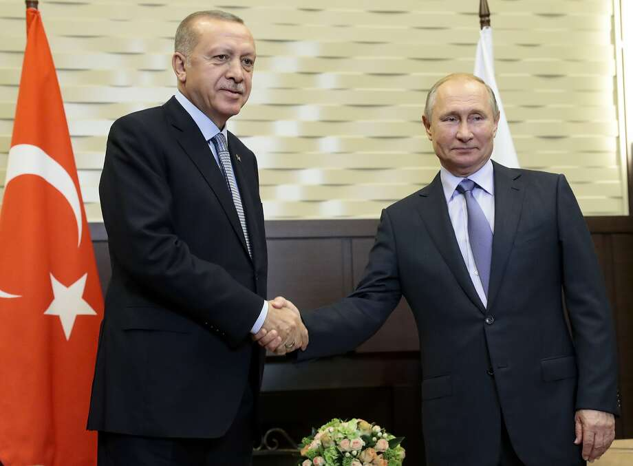 Russian President Vladimir Putin, right, and Turkish President Recep Tayyip Erdogan pose for a photo during their meeting in the Bocharov Ruchei residence in the Black Sea resort of Sochi, Russia, Tuesday, Oct. 22, 2019. Welcoming the Turkish leader in Russia's Black Sea resort of Sochi on Tuesday, Putin said their meeting is very important in the current tense situation in Syria. (AP Photo/Sergei Chirikov, Pool) Photo: Sergei Chirikov, Associated Press