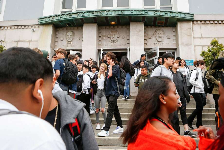 Students talk as they enter and exit George Washington High School in San Francisco. Photo: Amy Osborne / Special To The Chronicle