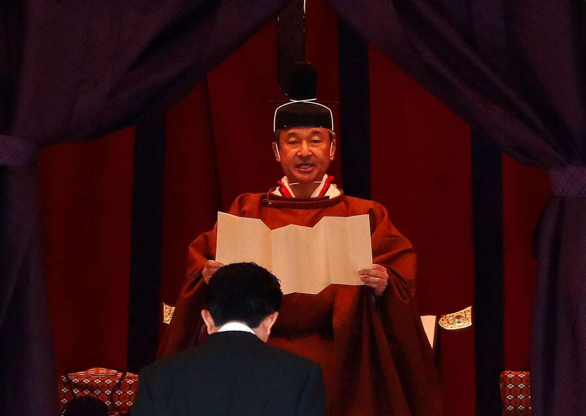 TOKYO, JAPAN - OCTOBER 22: Emperor Naruhito speaks near Japan's Prime Minister Shinzo Abe during a ceremony to proclaim his enthronement to the world, called Sokuirei-Seiden-no-gi, at the Imperial Palace on October 22, 2019 in Tokyo, Japan. (Photo by Pool/Getty Images)