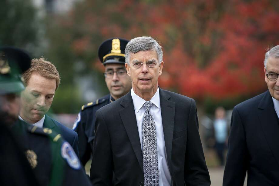 Ambassador William Taylor, is escorted by U.S. Capitol Police as he arrives to testify before House committees as part of the Democrats' impeachment investigation of President Donald Trump, at the Capitol in Washington, Tuesday, Oct. 22, 2019.  (AP Photo/J. Scott Applewhite) Photo: J. Scott Applewhite, Associated Press